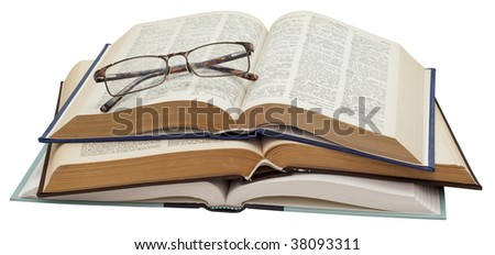 Folded glasses on a stack three open books on white background, saved with clipping path