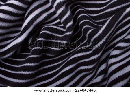 Folded Gray-Black Woolen Fabric - stock photo