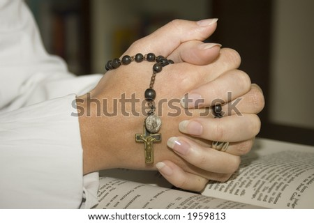 folded hands with rosary with clipping path for isolation - stock photo