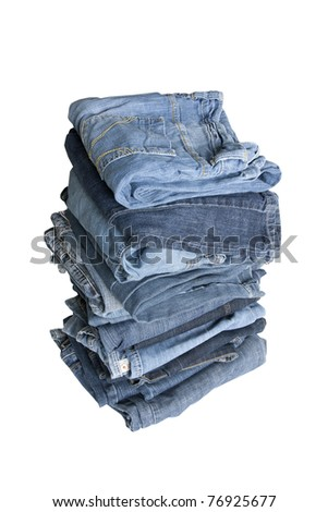 folded jeans in a pile on a white background