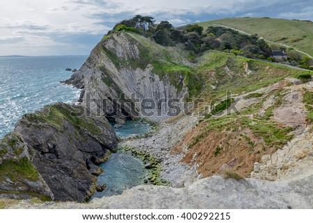folded limestone strata in Stair Hole cove West Lulworth, Isle of Purbeck, Dorset, England, United Kingdom - stock photo