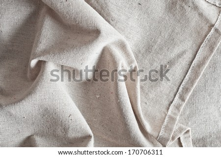 Folded linen fabric as a background image - stock photo
