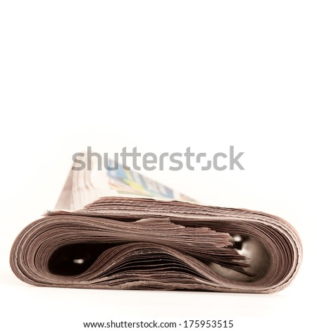 Folded newspaper isolated on white.