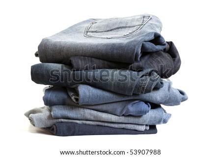 Folded Old Blue Jeans on isolated white background - stock photo