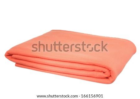 Folded orange Blanket isolated on white background - stock photo