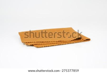 Folded orange napkin - stock photo