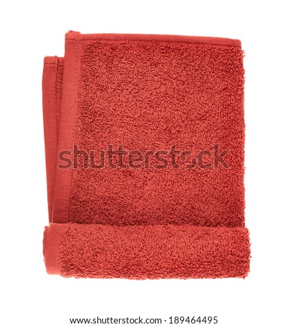 Folded red terry towel isolated over the white background - stock photo