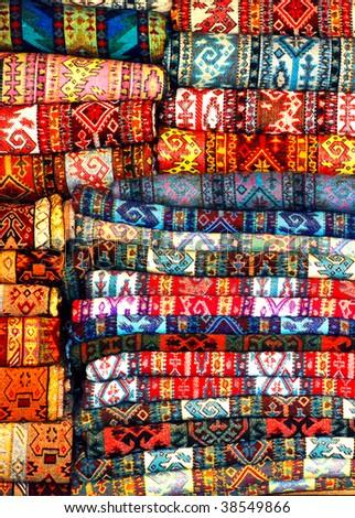 folded rugs - stock photo