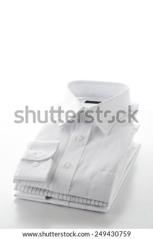 folded shirts on  white background - stock photo