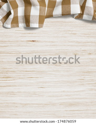 folded tablecloth over bleached wooden table - stock photo