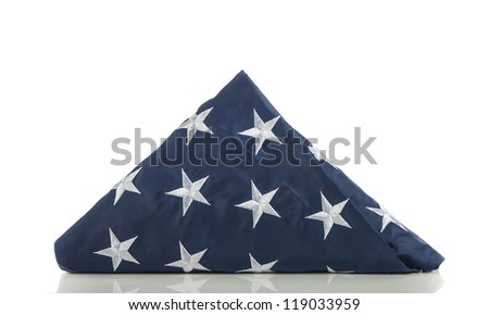 Folded US flag isolated on white - stock photo