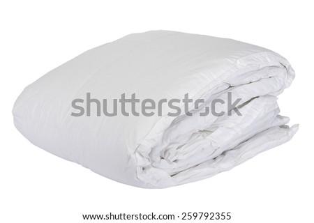 Folded white duvet cover on white isolated background - stock photo