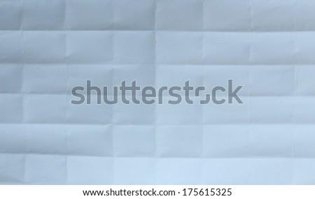 Folded white sheet of paper close up - stock photo