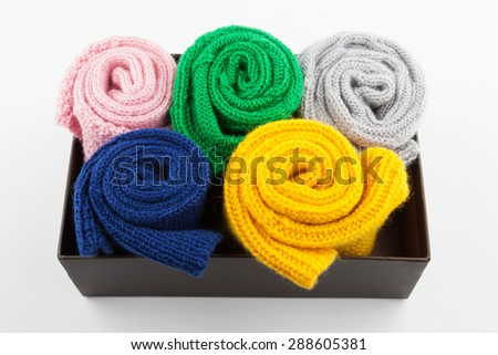 Folded wool socks in box on white