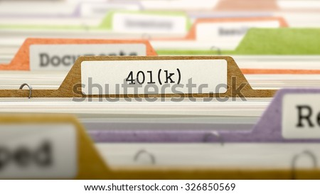 Folder in Colored Catalog Marked as 401k. Closeup View. Selective Focus. - stock photo