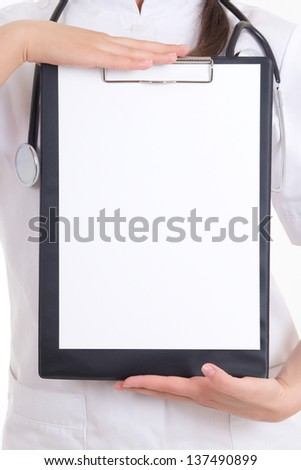 folder in female doctor's hands. copyspace - stock photo