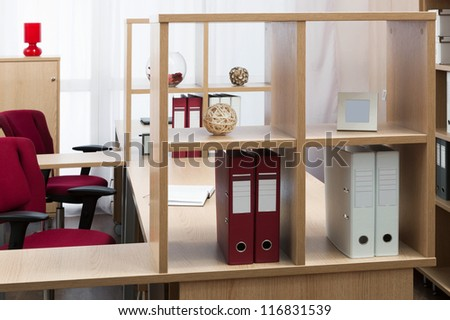 folder on the shelf on the table in a modern office - stock photo