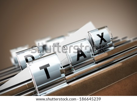 Folder tab with the word tax, beige background. Taxes concept for illustration of taxation. - stock photo