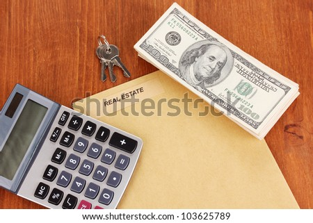 folder with information of real estate on wooden background close-up - stock photo