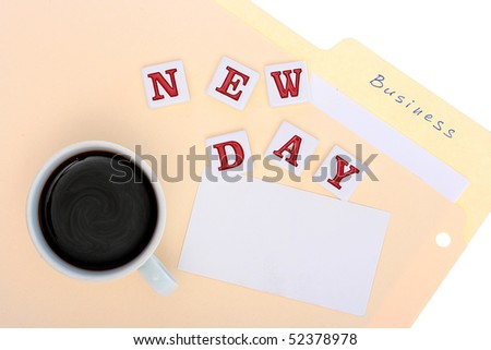 Folder with office documents, a cup of hot coffee and inscription New Day.