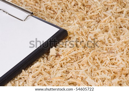folder with page of paper and wooden shaving - stock photo