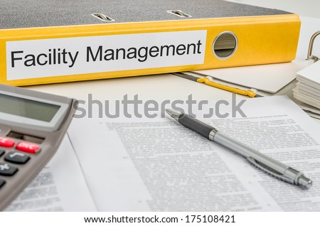 Folder with the label Facility Management - stock photo