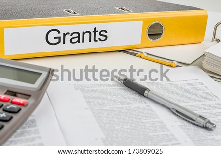 Folder with the label Grants - stock photo