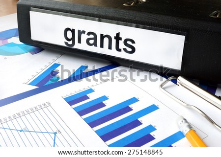 Folder with the label grants and charts - stock photo