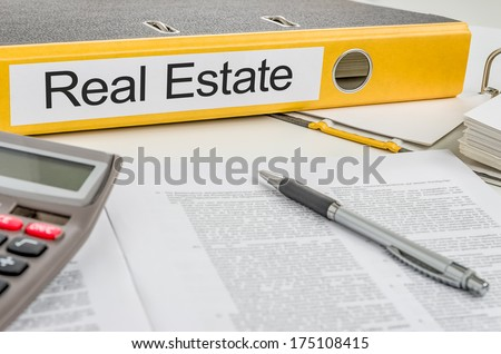 Folder with the label Real Estate - stock photo