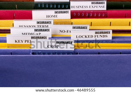 Folders for documents at office of the insurance company with Crop. - stock photo