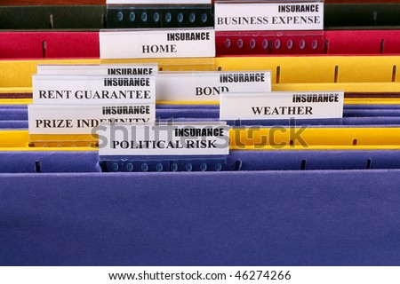 Folders for documents at office of the insurance company with Political Risk. - stock photo