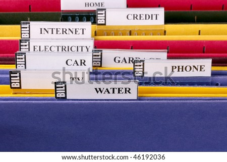 Folders for storage of documents in archive for the payment of invoices. - stock photo