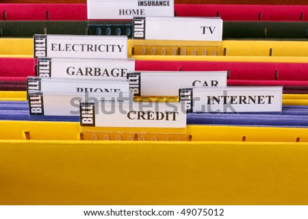 Folders in which are stored documents with bills and the information under credits. - stock photo