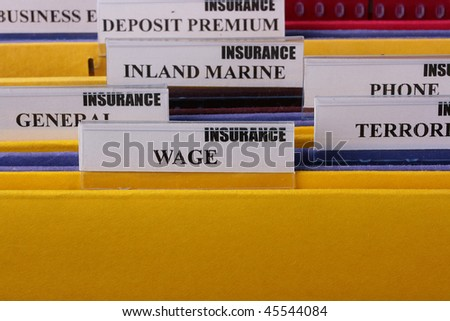 Folders with documents on insurance Wage in the insurance company. - stock photo