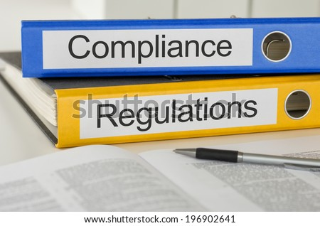 Folders with the label Compliance and Regulations - stock photo