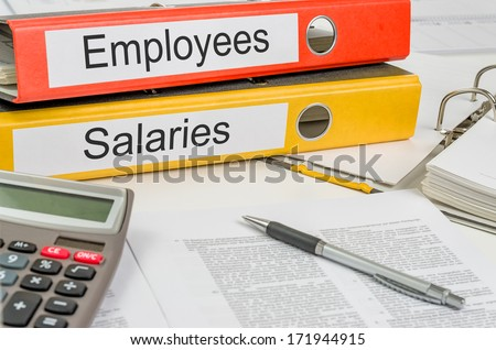 Folders with the label Employees and Salaries - stock photo