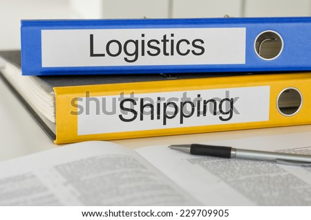 Folders with the label Logistics and Shipping - stock photo