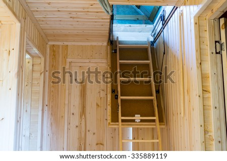 Folding attic ladder - stock photo