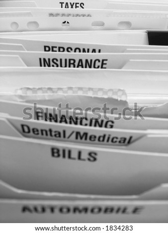 Folding file system with categories illustrating some of the elements of a busy life - stock photo
