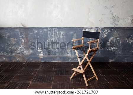 folding high chair at the wall, vintage background - stock photo