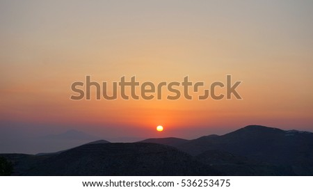 Folegandros picturesque island, sunset in the Aegean, Cyclades, Greece
