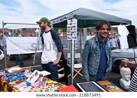 FOLKESTONE, UK-AUGUST 30:  Artist  Matt Rowe & Club Shepway  sell work at the  Art Car Boot Fair. Part of the Folkestone Triennial. August 30, 2014, Folkestone UK - stock photo