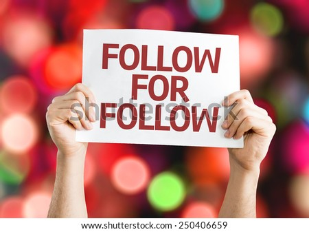 Follow for Follow card with colorful background with defocused lights - stock photo