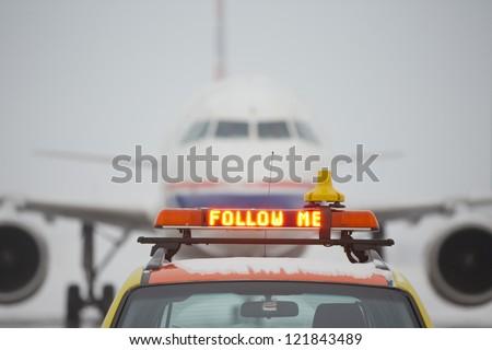 Follow me cars on airport - selective focus - stock photo