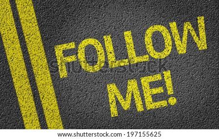 Follow me written on the road - stock photo