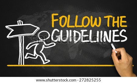 follow the guidelines concept handwritten on blackboard - stock photo
