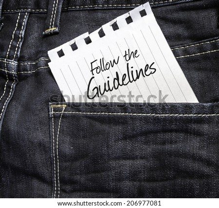 Follow the Guidelines written on a peace of paper on a jeans background  - stock photo