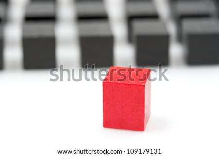 Follow the leader: red block in focus - stock photo