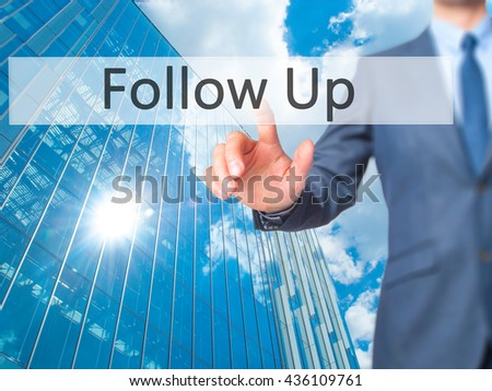 Follow Up - Businessman hand pressing button on touch screen interface. Business, technology, internet concept. Stock Photo