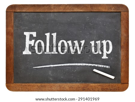 Follow up sign- text in white chalk on a vintage slate blackboard - stock photo